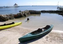 Tashi_on_Beach_with_Kayaks-1